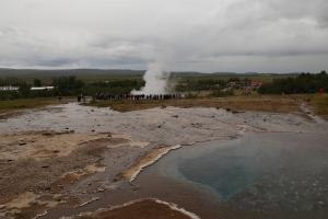 View of Strokkur geyser erupting from Geysir