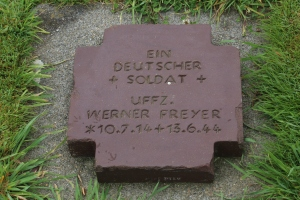 Each grave is marked with a clay marker that lists two soldiers. This one includes an unknown soldier.
