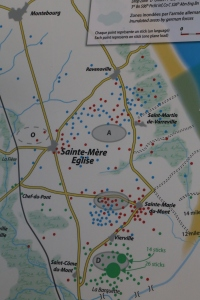 The lettered bubbles show the planned drop zones. The tiny dots show where the paratrooper groups actually landed.