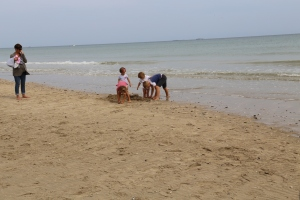 Some adorable French children playing on Utah Beach.
