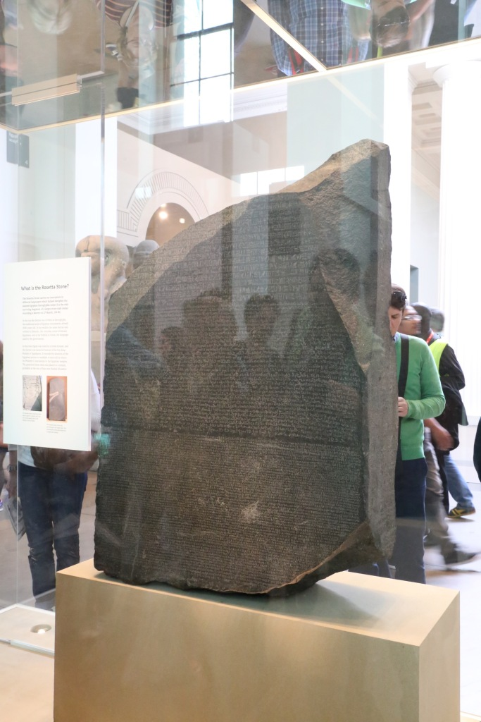 This rather awful picture shows the Rosetta Stone, perhaps the most famous in the Museum's collection. Its discovery in 1799 allowed scholars to  map hieroglyphs to Greek and understand their meaning for the first time.