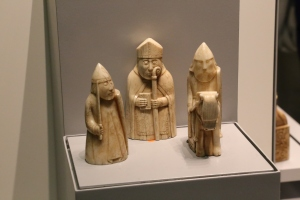 Three of the 78 Lewis Chessmen.  These medieval walrus ivory chess pieces were found in Western Scotland in 1831. Half of them were painted red instead of the black we use today.