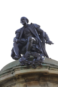 Shakespeare statue along the Avon River. The statue is surrounded by four of his most famous characters.
