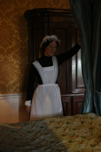 One of the maids making the bed upstairs -- the dialog in this room was between her and a footman, who told her to keep her head down, do a good job, and the Countess would be inviting her to the theater in no time... riiiiight.