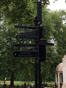 Sign outside Hyde Park Circle directing visitors to iconic London sites.