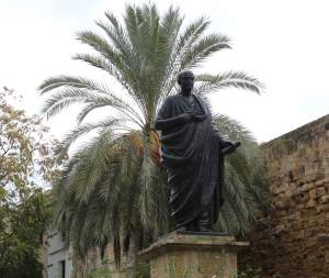 Statue of Seneca next to the entrance to the Old Town