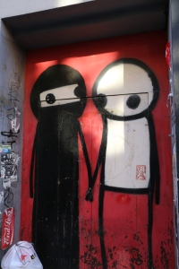 This piece is by Stik - he usually does stick figures but made the piece fit its environment in this Muslim Bangladeshi neighborhood