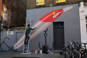 This artist from Spain is working on his mural on Hanbury St.