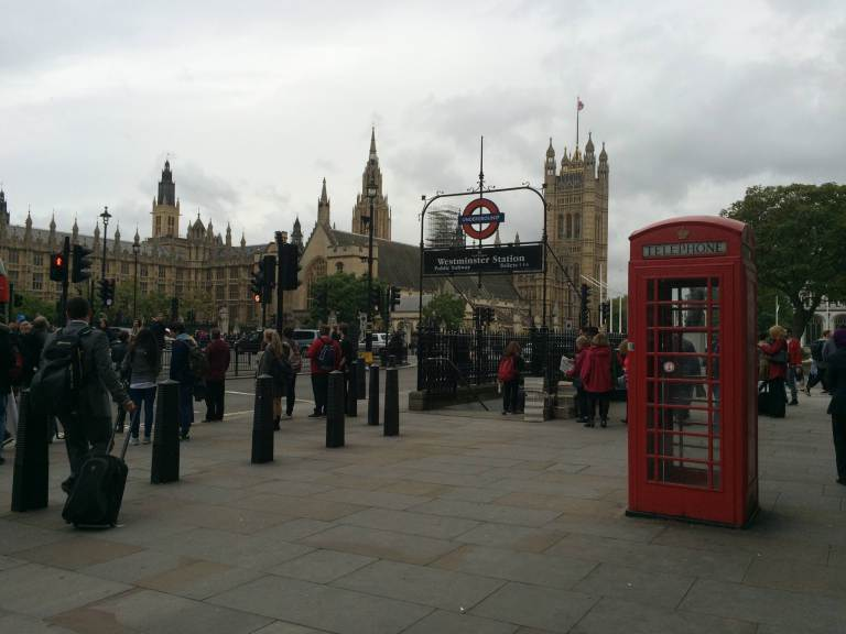 The most London-y photo ever taken: red phone booth, Westminster Tube station, Houses of Parliament