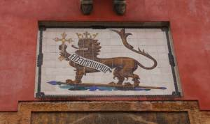 This lion crest adorns the top of the Door of the Lion, earning the door its name