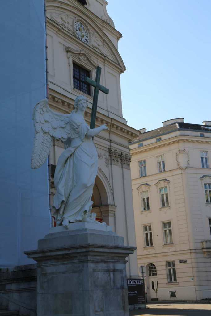 One of the two angels in front of the church