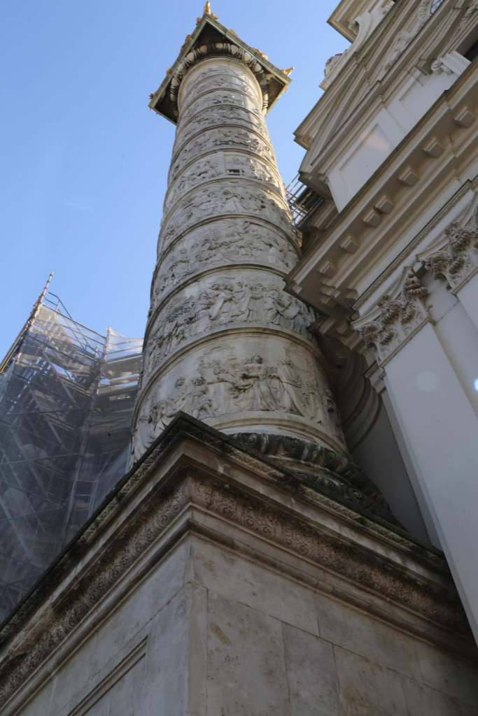 One of the two victory columns at the front of the church