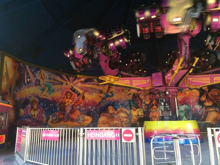This ride played German techno music crazy loud, and check out the art behind the ride.