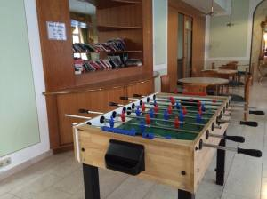 What student housing would be complete without foosball and the orphaned books shelf?